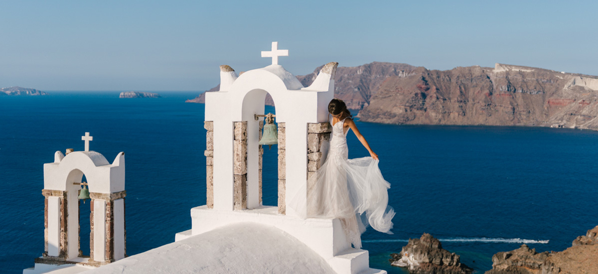 cover in phosart photography santorini weddings destination wedding cinematography photo island greek greece thira weddingday bride groom